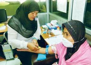 Proses pemeriksaan pasien tuberkulosis di Puskesmas, kota Bogor.